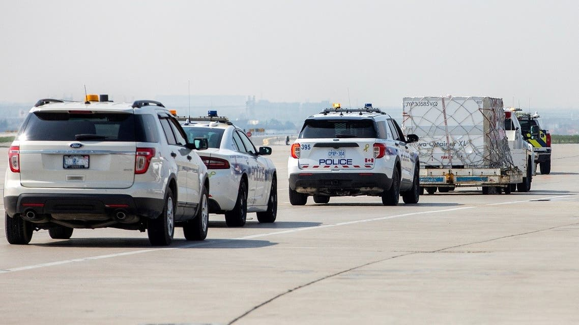 Police escort a shipment from South Africa of the Johnson & Johnson vaccine against the coronavirus  at Toronto Pearson Airport in Mississauga, Ontario, Canada, on April 28, 2021. (Reuters)