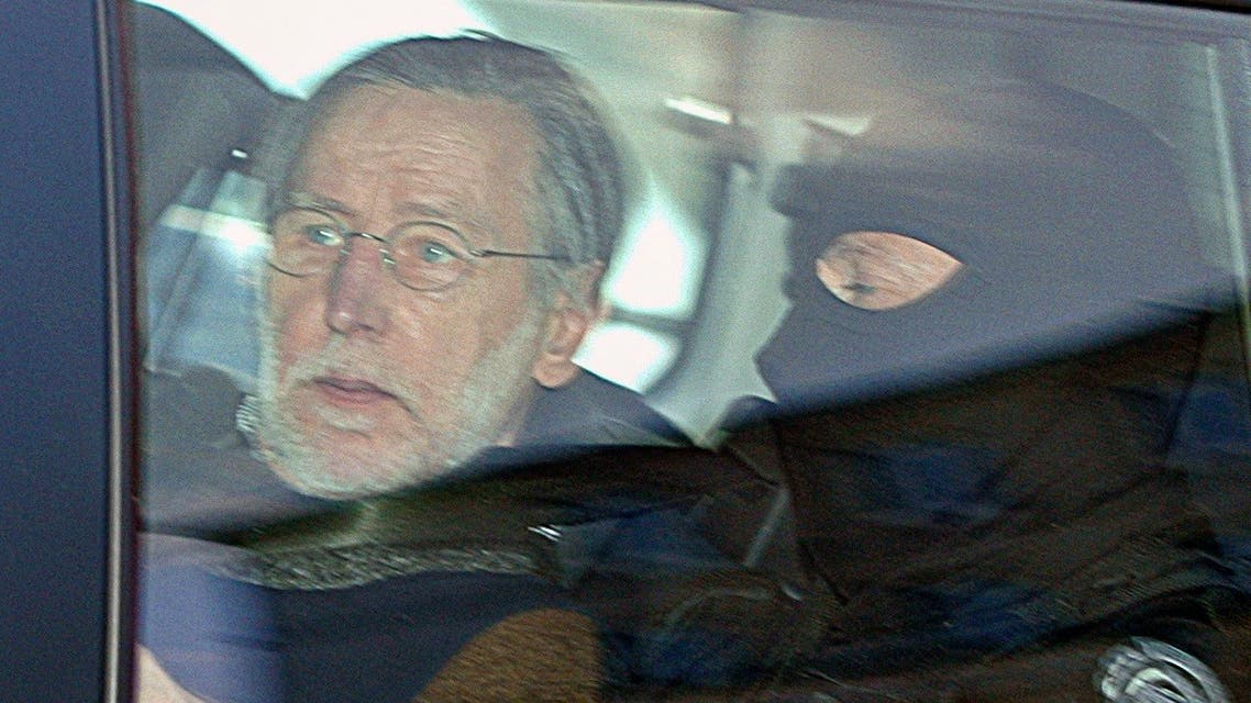 A file photo shows French self-confessed serial killer Michel Fourniret arrives in a police car to attend his trial at the Charleville-Mezieres courthouse, northern France, on May 20, 2008. (AFP)