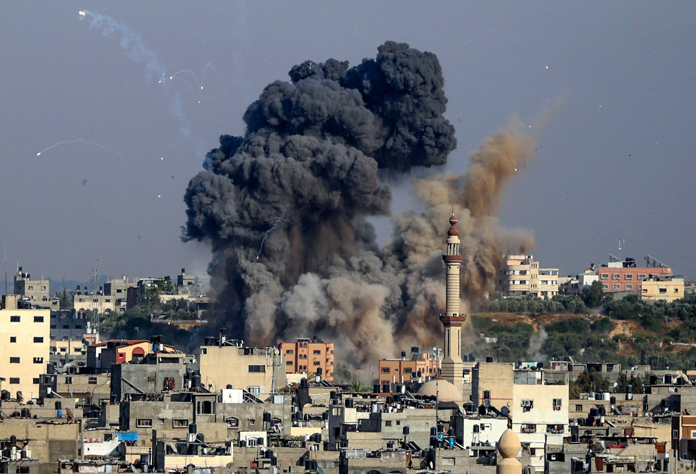 Smoke billows from Israeli air strikes in Gaza City, controlled by the Palestinian Hamas movement, on May 11, 2021.