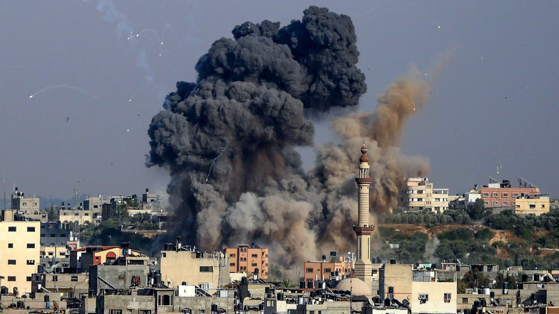 Smoke billows from Israeli air strikes in Gaza City, controlled by the Palestinian Hamas movement, on May 11, 2021. Israel and the Islamist movement Hamas in Gaza exchanged heavy fire, killing at least 26 Palestinians and two Israelis, in an escalation sparked by violent unrest at Jerusalem's flashpoint Al-Aqsa Mosque compound. ANAS BABA / AFP