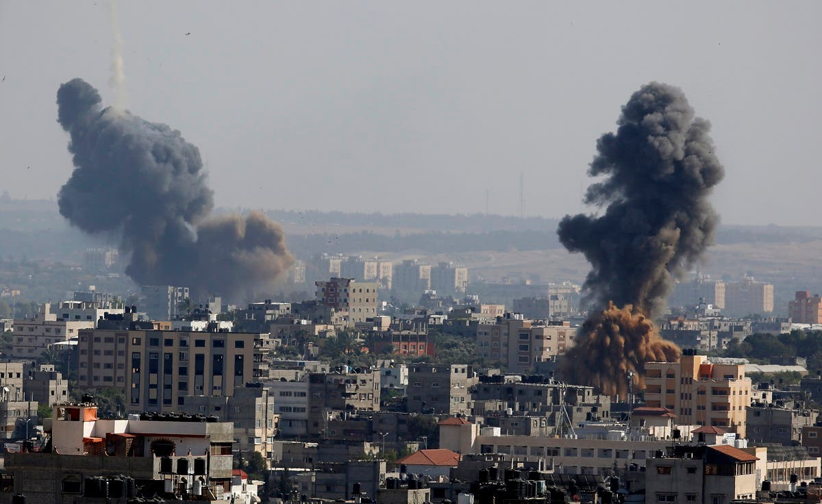 Smoke rises after Israeli airstrikes in Gaza in Gaza City, May 11, 2021. (AP/Hatem Moussa)