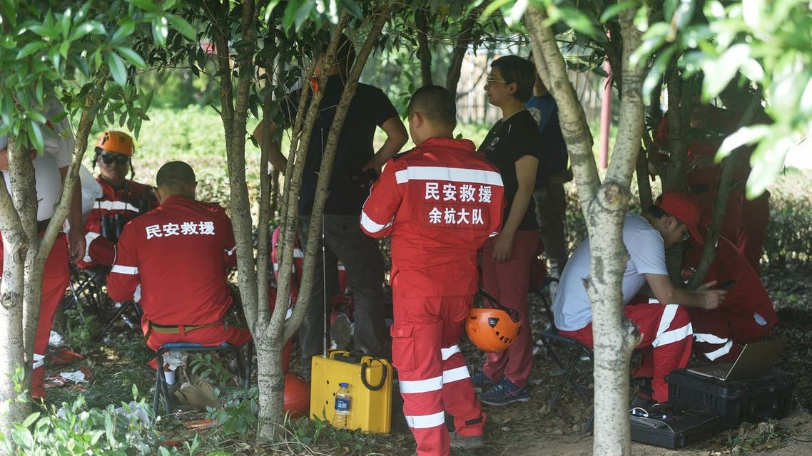 This photo taken on May 9, 2021 shows rescuers searching leopards which escaped from a wild park in Hangzhou, in China's eastern Zhejiang province. (File photo: AFP)