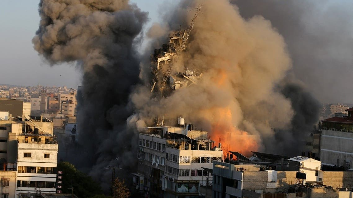 A tower building collapses after it was hit by Israeli air strikes amid a flare-up of Israeli-Palestinian violence, in Gaza City May 12, 2021. (Reuters)