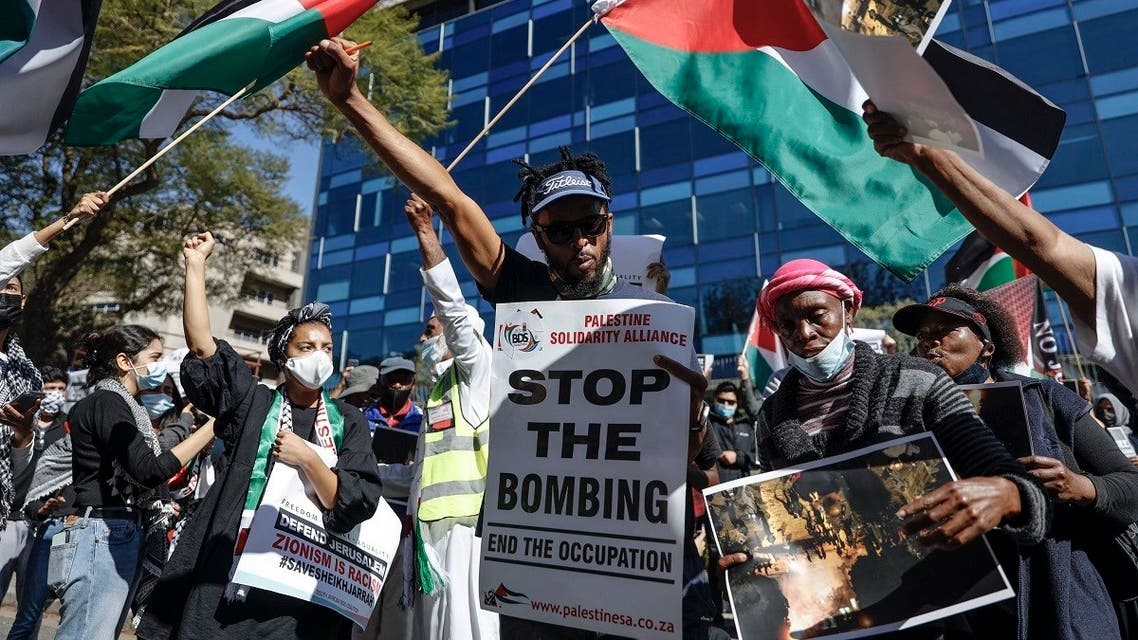 Demonstrators gather outside of the Israel Trade office in Sandton, Johannesburg, on May 11, 2021 during a protest against Israeli attacks on Palestinians in Gaza. (Guillem Sartorio/AFP)