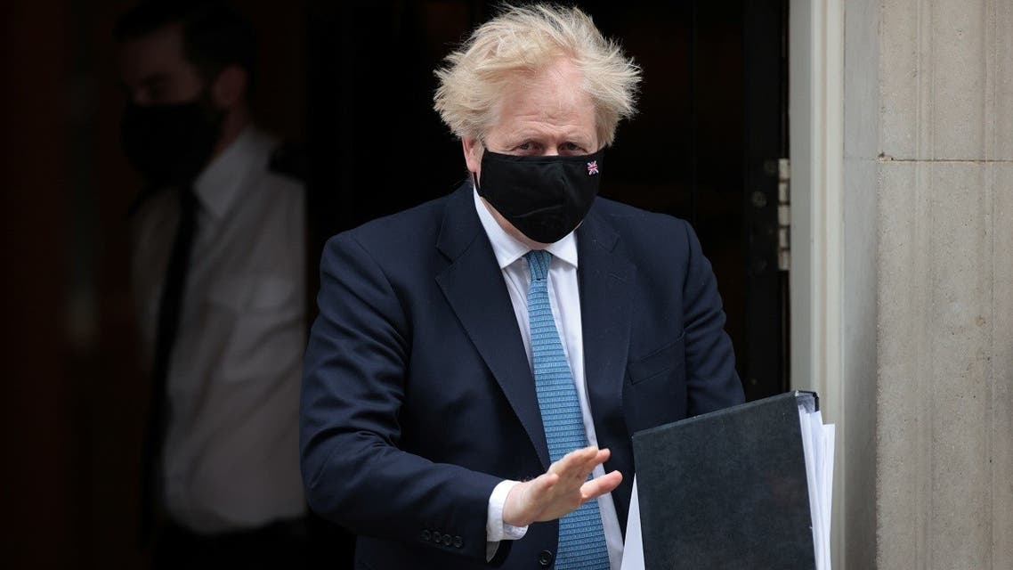 Britain's Prime Minister Boris Johnson walks outside Downing Street in London, Britain, on May 12, 2021. (Reuters)