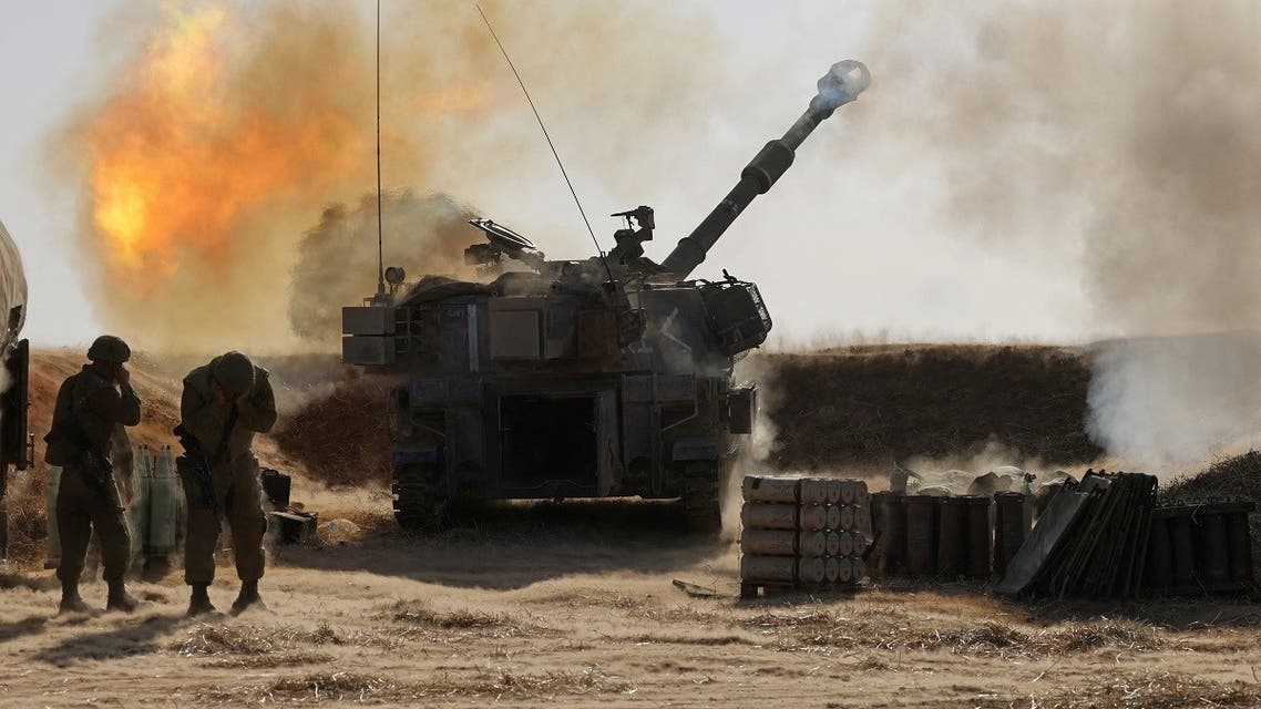 Israeli soldiers fire a 155mm self-propelled howitzer toward targets in the Gaza Strip from their position near the southern Israeli city of Sderot on May 12, 2021. (Menahem Kahana/AFP)