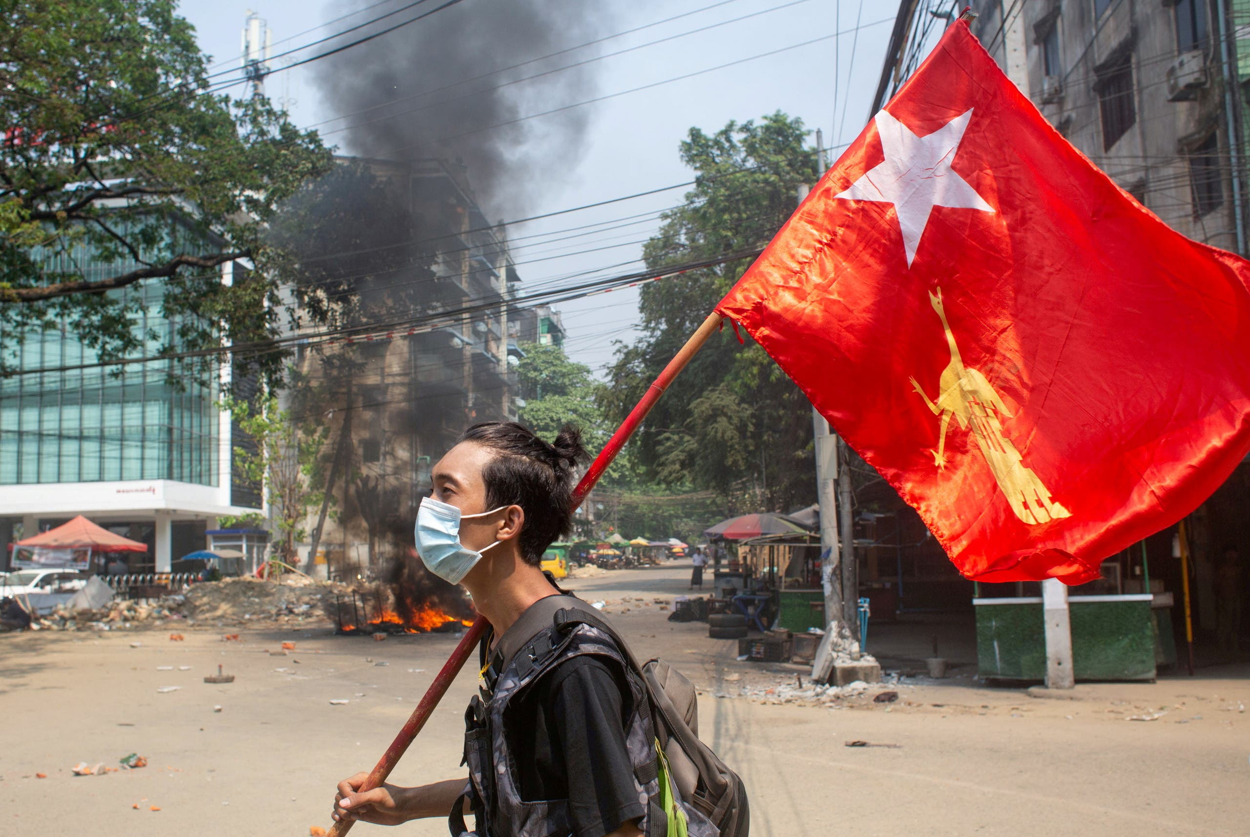 A man holds a National League for Democracy (NLD) flag during a protest against the military coup, in Yangon, Myanmar March 27, 2021. (File Photo: Reuters)