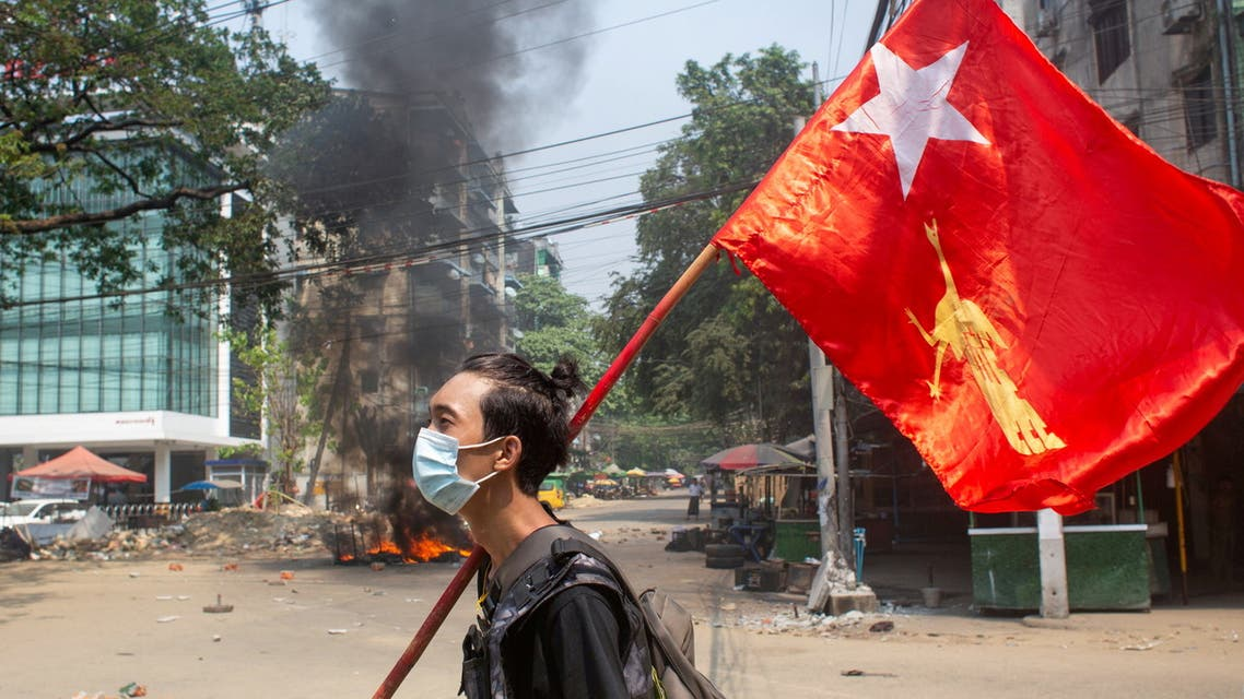 FILE PHOTO: A man holds a National League for Democracy (NLD) flag during a protest against the military coup, in Yangon, Myanmar March 27, 2021. (File Photo: Reuters)
