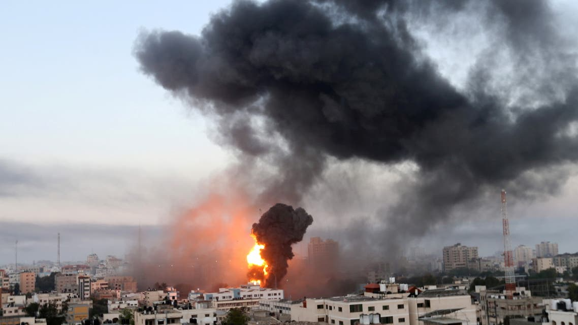 Smoke and flames rise during Israeli air strikes amid a flare-up of Israeli-Palestinian violence, in Gaza May 12, 2021. (Reuters)