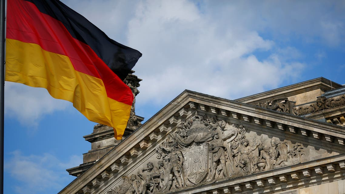 A German flag flutters in front of the Reichstag building in Berlin, Germany, September 6, 2020. Letters read To the German people. Picture taken September 6, 2020. (Reuters)