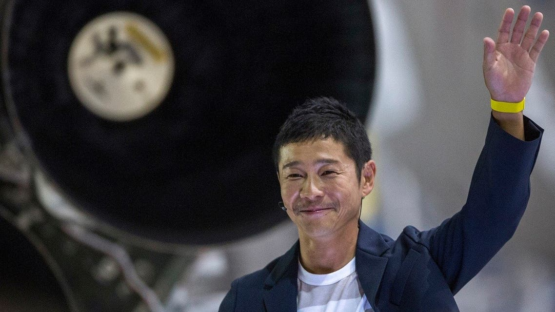 Japanese billionaire Yusaku Maezawa gestures near a Falcon 9 rocket during the announcement by Elon Musk to be the first private passenger who will fly around the Moon aboard the SpaceX BFR launch vehicle, at the SpaceX headquarters and rocket factory in Hawthorne, California. (AFP)