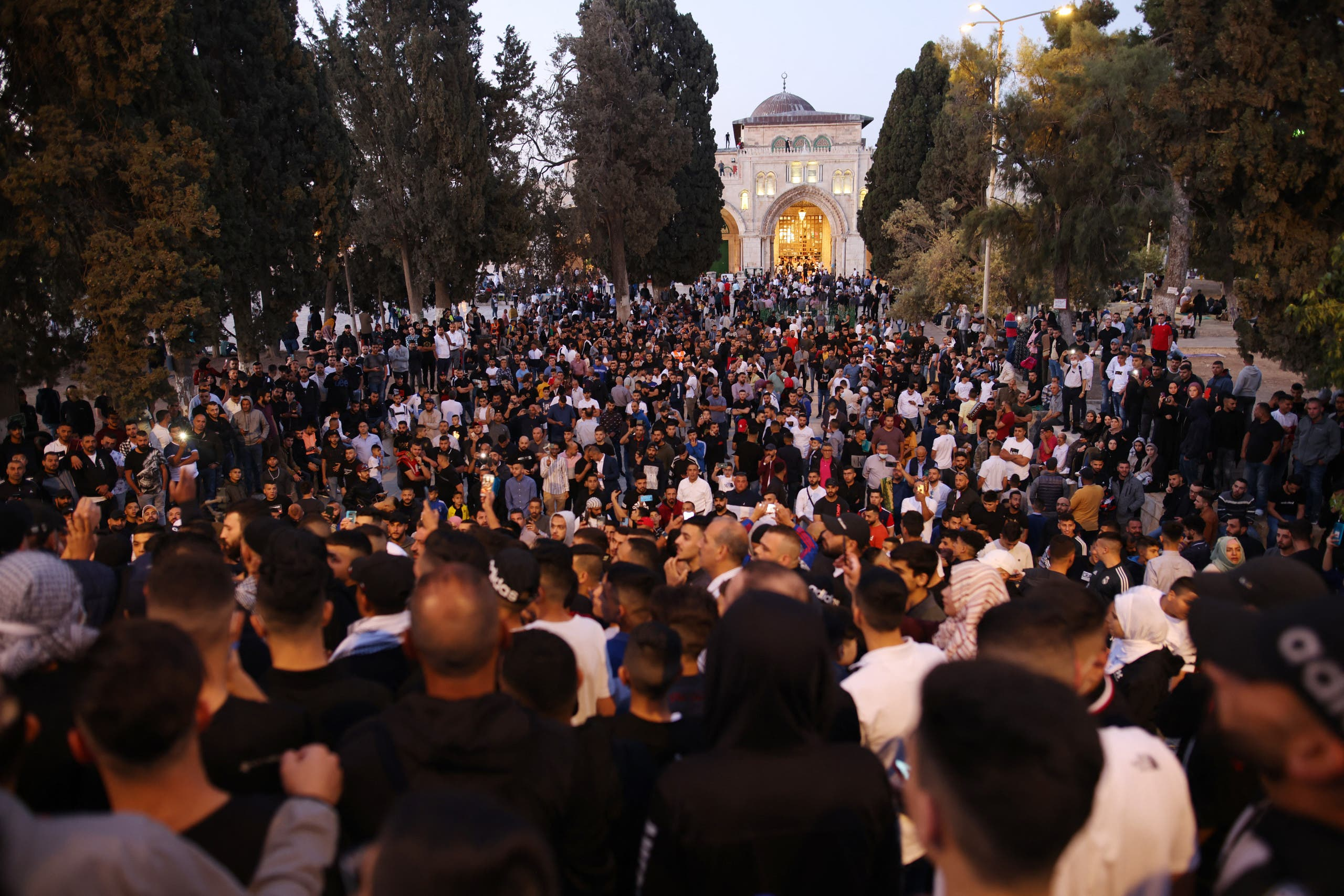 Muslim worshippers gather at the al-Aqsa mosques compound in Old Jerusalem for the morning Eid al-Fitr prayer early on May 13, 2021. (AFP)