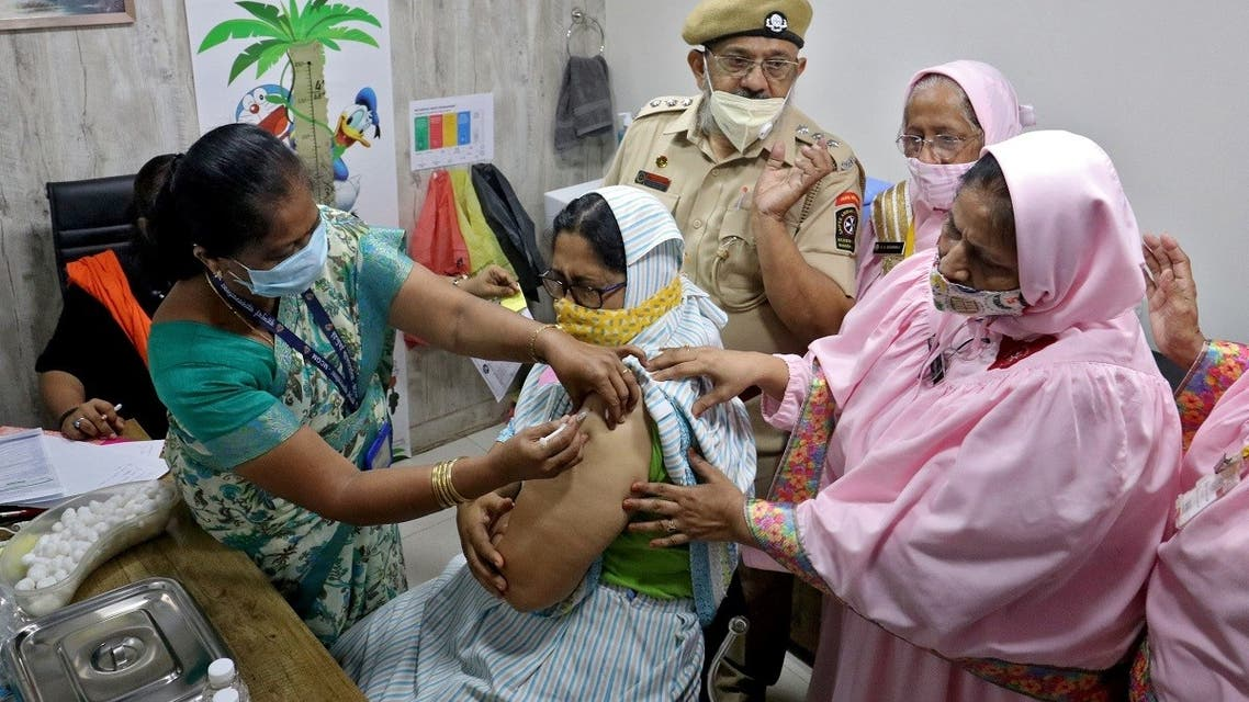 Monira Abbas Bhagasrala, 53, receives a dose of COVISHIELD, a coronavirus vaccine manufactured by Serum Institute of India, at a vaccination centre in Mumbai, India, on May 6, 2021. (Reuters)
