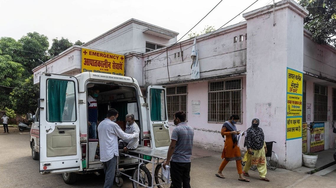 Relatives help Jagdish Singh, 57, out of an ambulance outside a government-run hospital to receive treatment, amidst the coronavirus, in Bijnor district, Uttar Pradesh, India, on May 11, 2021. (Reuters)