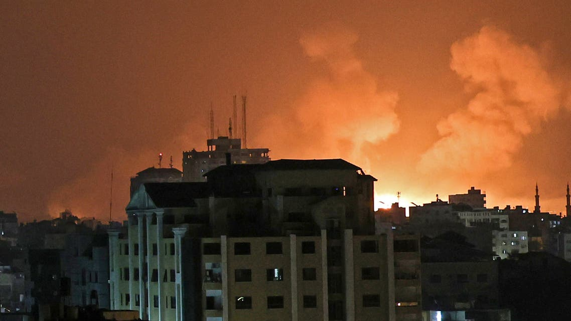An explosion lights the sky following an Israeli air strike on Beit Lahia in the northern Gaza Strip on May 14, 2021. (AFP)