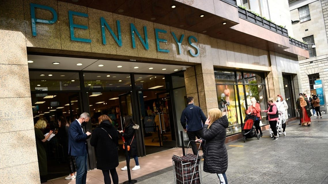 People keeping social distance queue outside a Penneys clothes shop, as a phased reopening by appointment shopping following Government guidance begins, after an extended lockdown due to the coronavirus outbreak, in Dublin, Ireland, on May 10, 2021. (Reuters)