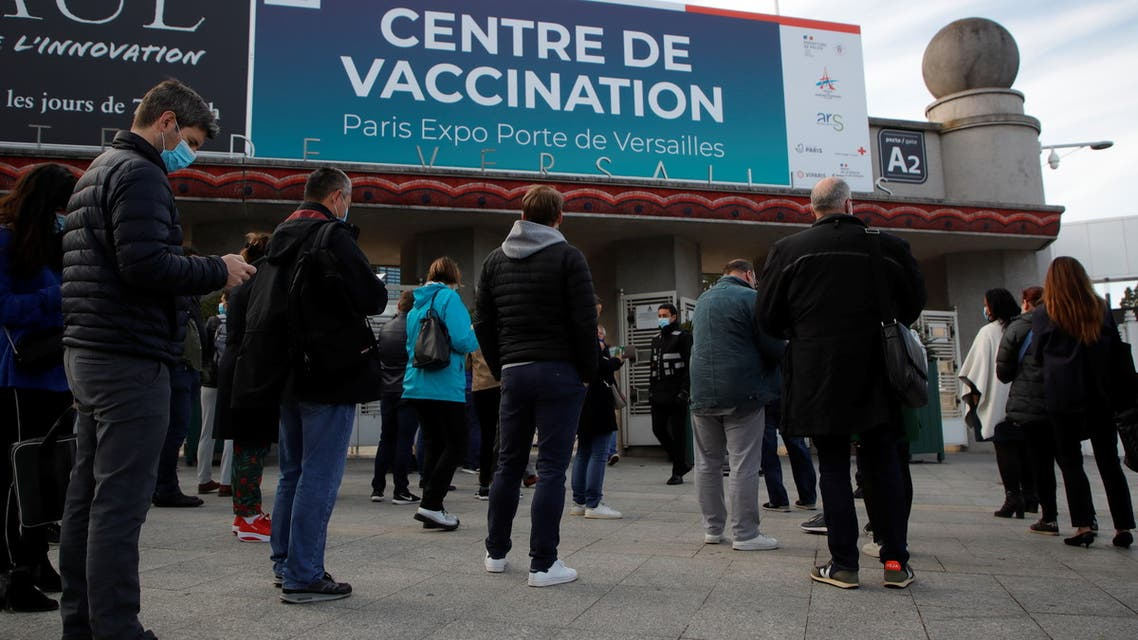 People wait outside a mass vaccination center in Paris, as part of the coronavirus disease (COVID-19) vaccination campaign in France, May 12, 2021. (Reuters)