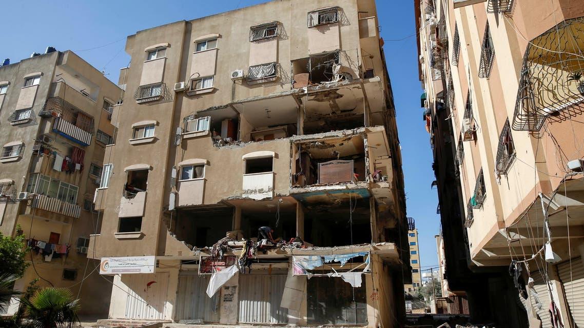 أحد المباني المدمرة في غزة (رويترز)