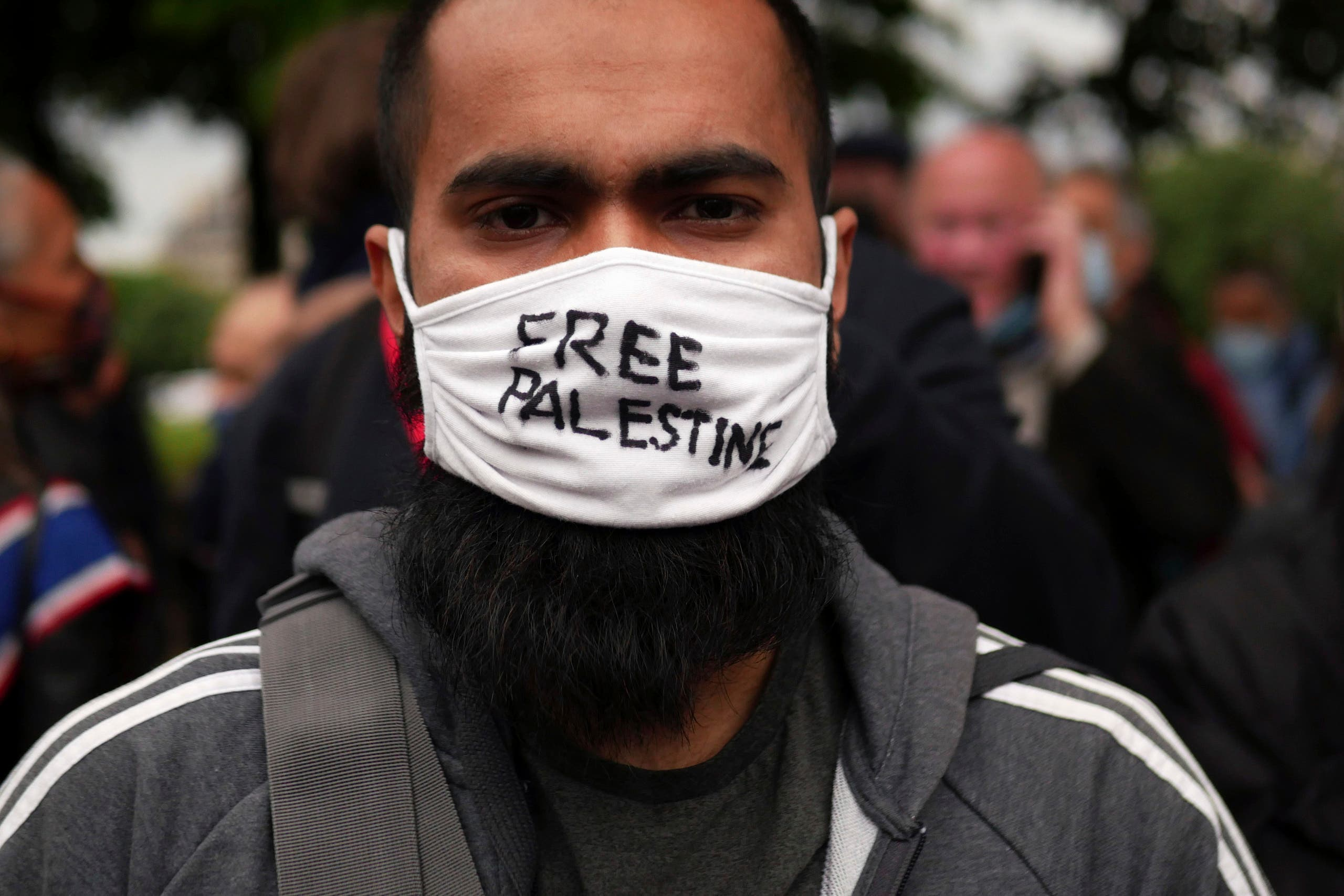A protester wears a face mask reading Free Palestine during a protest in solidarity with Palestinians, in Paris, Wednesday, May 12, 2021. (AP)