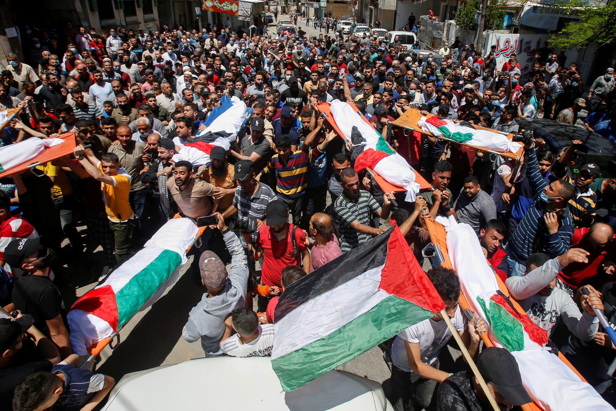 تشييع قتلى نتيجة القصف الإسرائيلي على غزة 15 مايو 2021 - رويترز