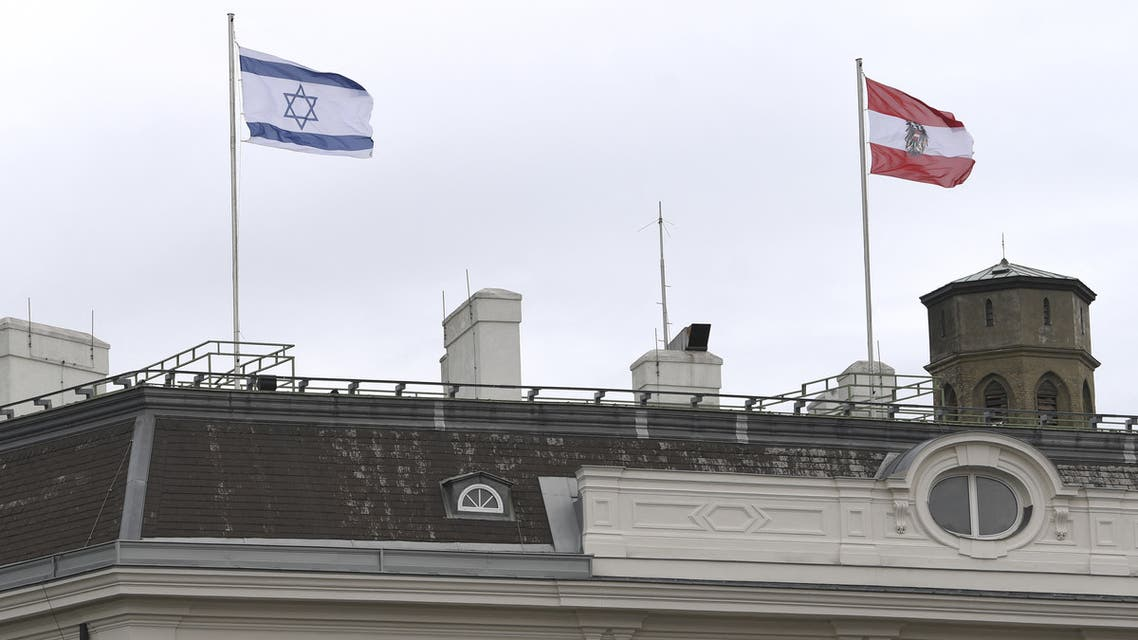 The Austrian Federal Chancellery raised the Israeli flag (Up L) as a sign of solidarity, in Vienna on May 14, 2021. (AFP)
