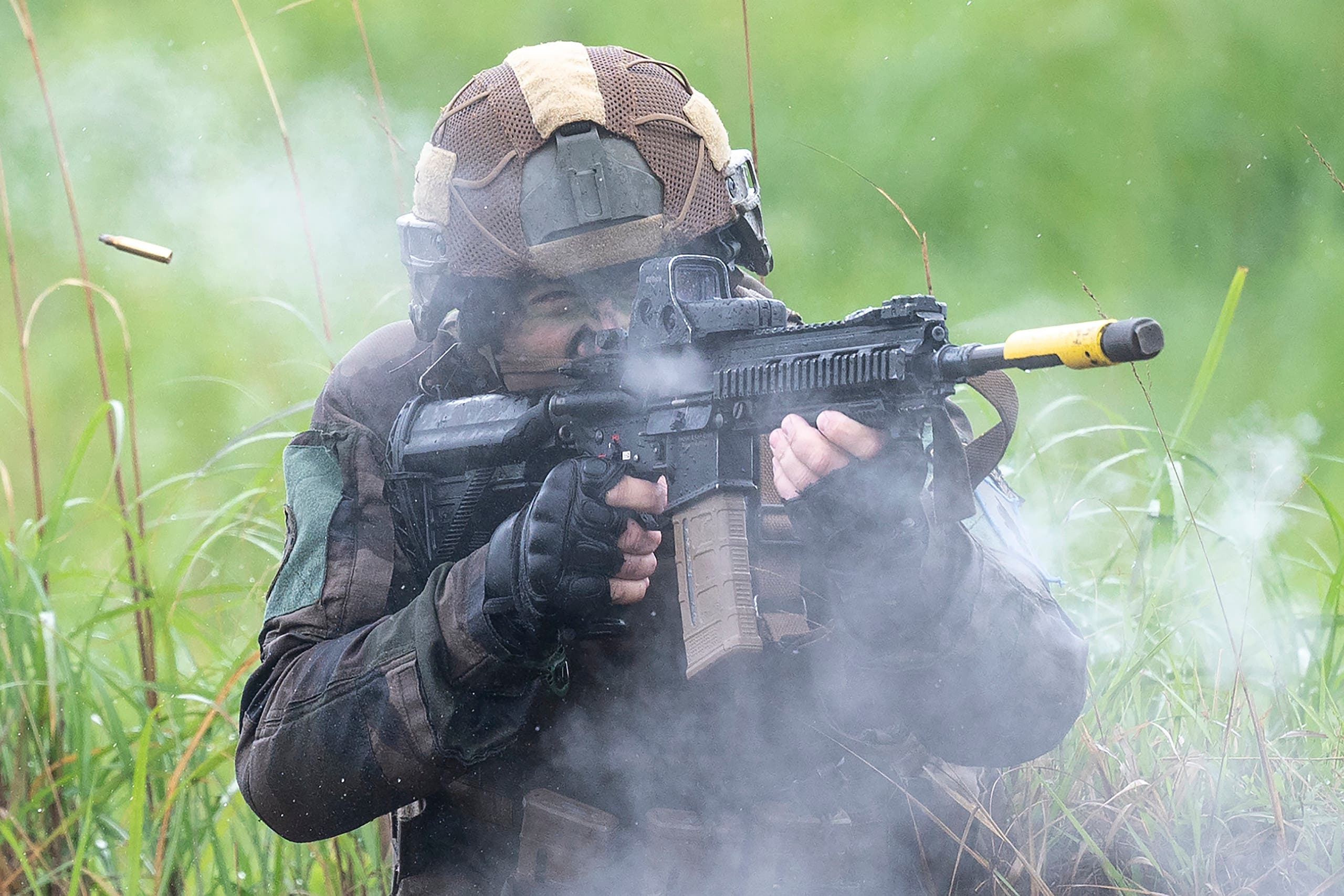 A French army soldier take part in a joint military drill between Japan Self-Defense Force, French army and U.S. Marines, at the Kirishima exercise area in Ebino, Miyazaki prefecture, southern Japan Saturday, May 15, 2021. (AP)