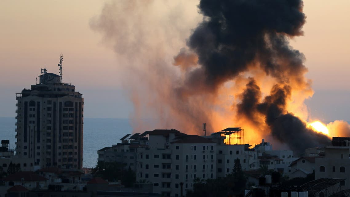 Smoke and flame rise during Israeli air strikes in Gaza City on May 14, 2021. (Reuters)