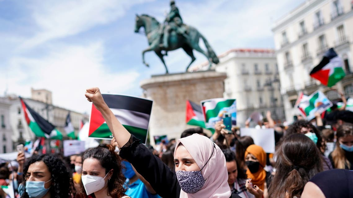 People take part in a protest in support of Palestinians amid their ongoing conflict with Israel, at Puerta del Sol square, in Madrid, Spain May 15, 2021. (Reuters)