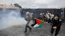 Greek police fire water at pro-Palestinian demonstrators in front of Israeli embassy