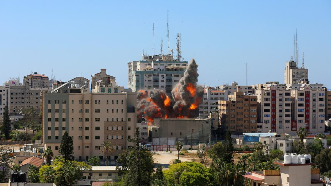 A tower housing AP, Al Jazeera offices collapses after Israeli missile strikes in Gaza city on May 15, 2021. (Reuters)