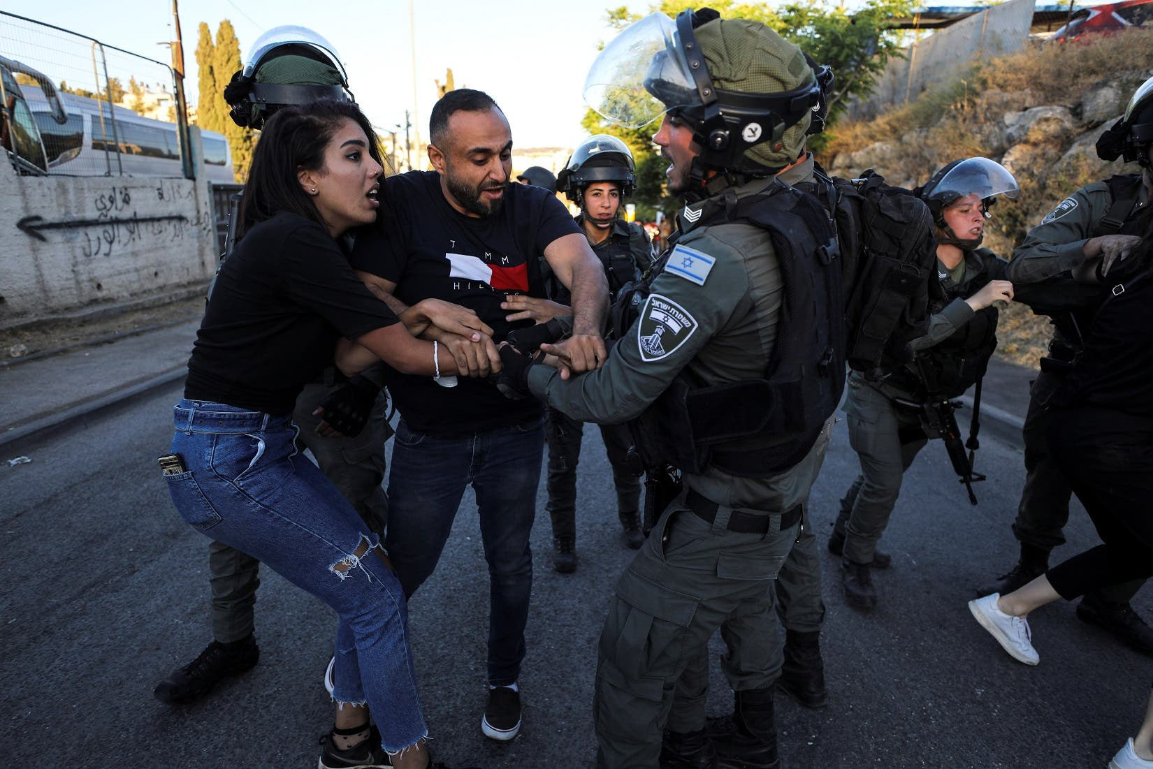 Israeli Border police officers scuffle with Palestinian protesters in East Jerusalem May 15, 2021. (Reuters)