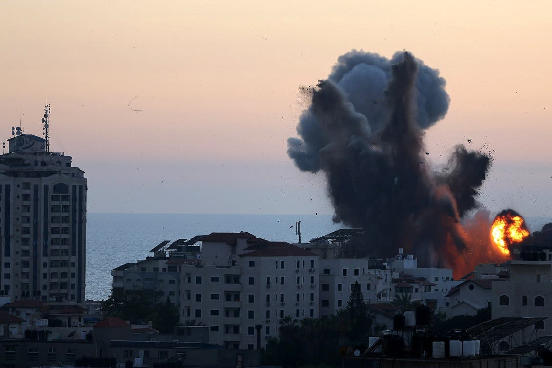 Smoke and flame rise during Israeli air strikes, as cross-border violence between the Israeli military and Palestinian militants continues, in Gaza City, May 14, 2021. (Reuters)