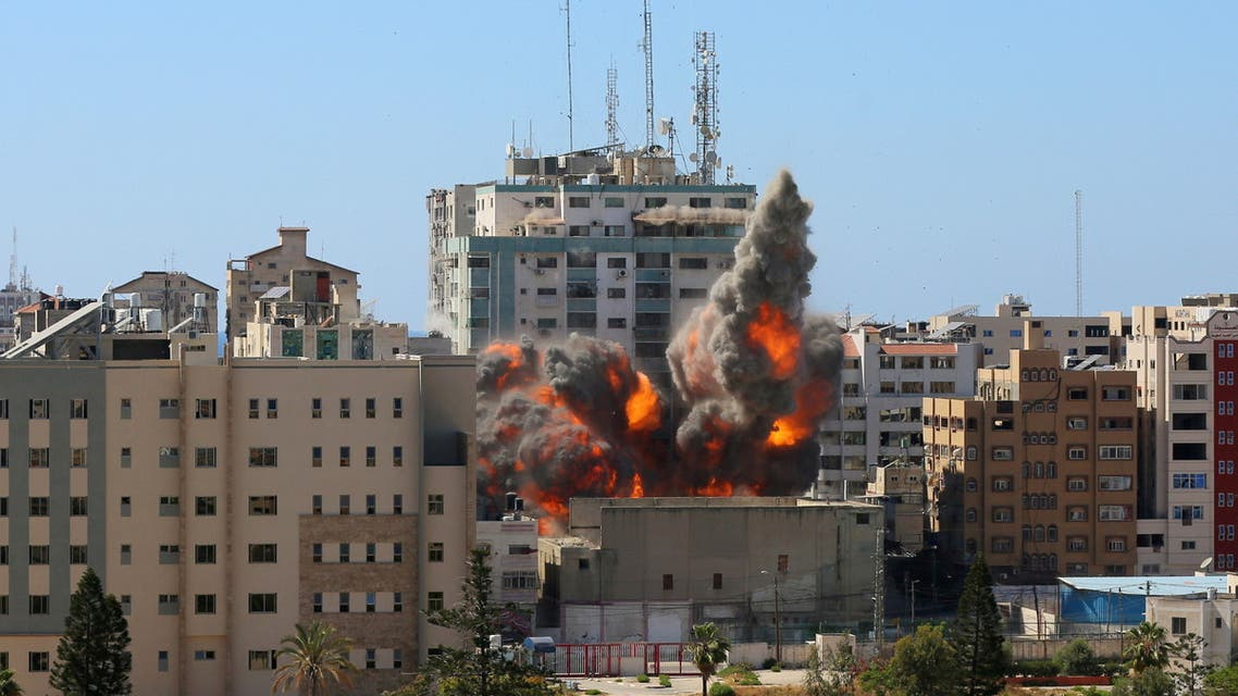 An explosion is seen near a tower housing AP, Al Jazeera offices (C) during Israeli missile strikes in Gaza city, May 15, 2021. (Reuters)