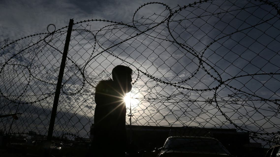 A Palestinian man waits to leave Rafah border crossing after it was opened by Egyptian authorities, in the southern Gaza Strip February 9, 2021. (Reuters)