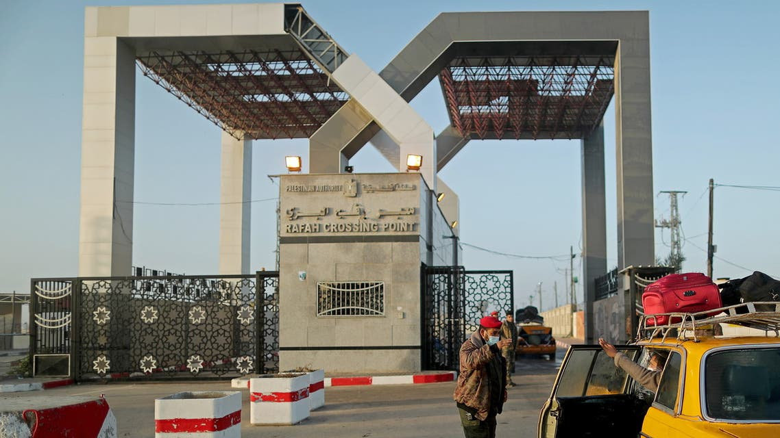 A Palestinian security officer checks passengers at Rafah border crossing after it was opened by Egyptian authorities, in the southern Gaza Strip February February 11, 2021. (Reuters)