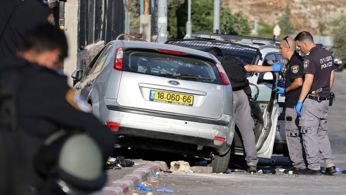 Israeli security forces work at the scene of what police said was a suspected car-ramming attack, at the entrance to Sheikh Jarrah neighbourhood of East Jerusalem May 16, 2021. (Reuters)