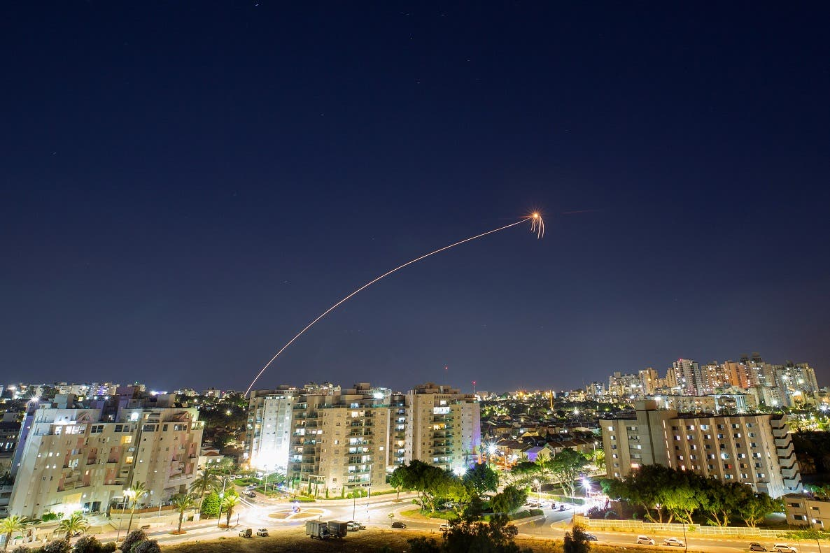 A streak of light is seen as Israel's Iron Dome anti-missile system intercepts rockets launched from the Gaza Strip towards Israel, as seen from Ashkelon, Israel May 15, 2021. (Reuters)