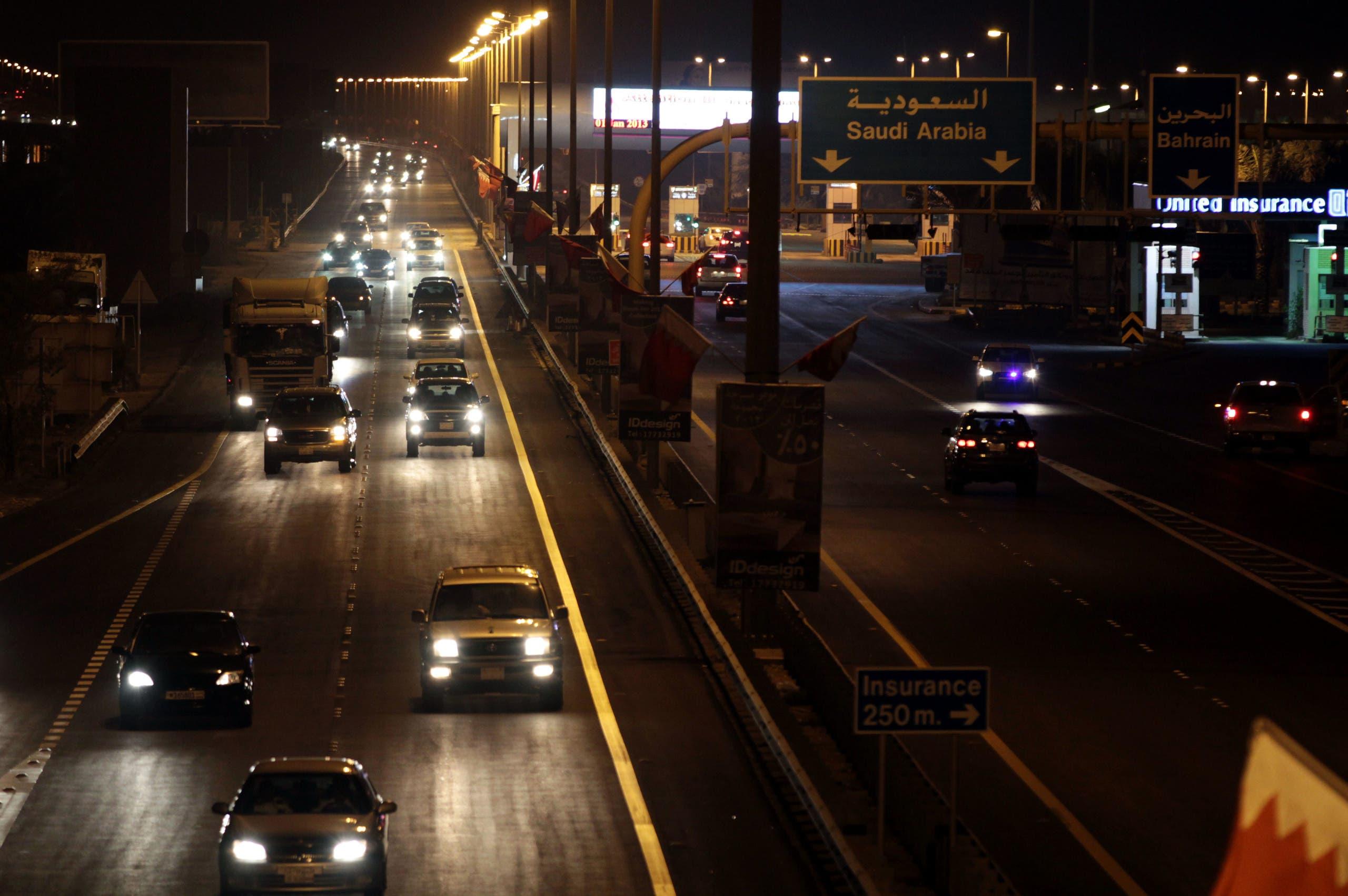 Vehicles travel into Bahrain from Saudi Arabia at King Fahd causeway Tuesday night, Jan. 1, 2013. (AP)