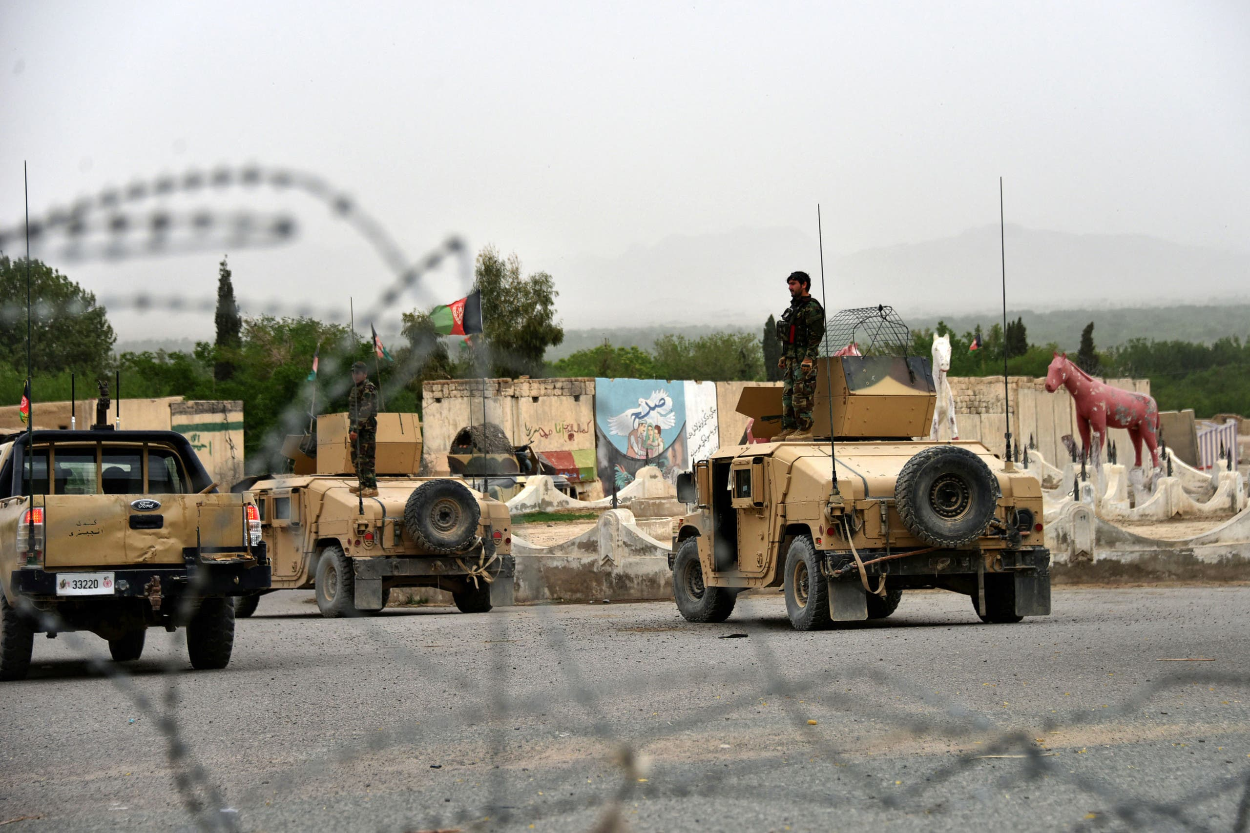 In this file photo taken on April 04, 2021 Afghan security forces stand on Humvee vehicles during a military operation in Arghandab district of Kandahar province. (AFP)
