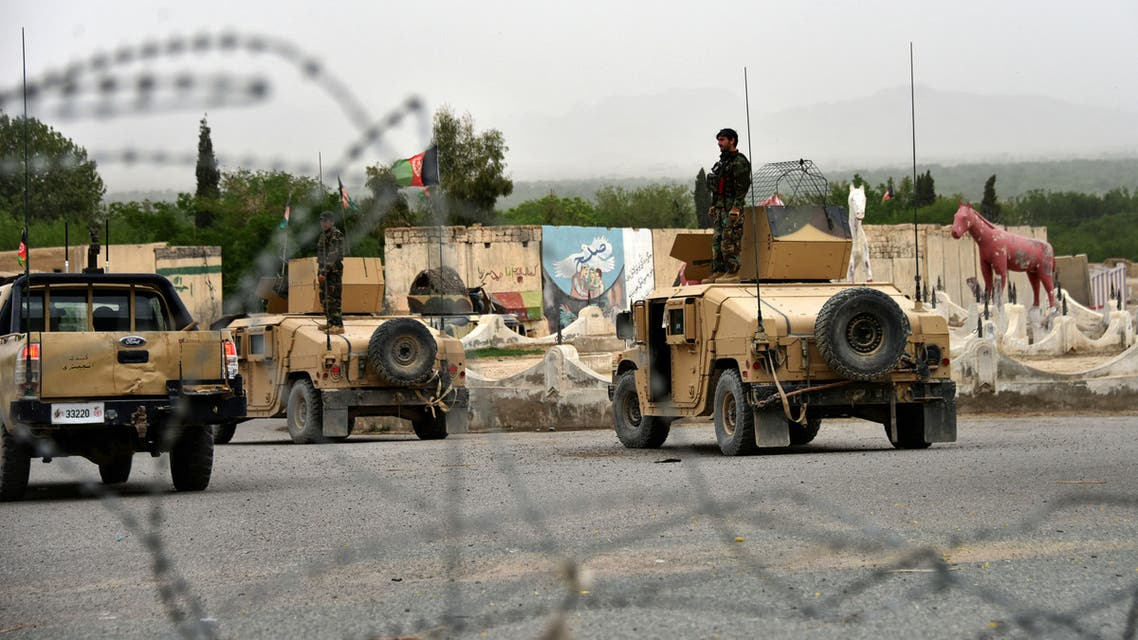 Afghan security forces stand on Humvee vehicles during a military operation in Kandahar province, April 4, 2021. (Reuters)