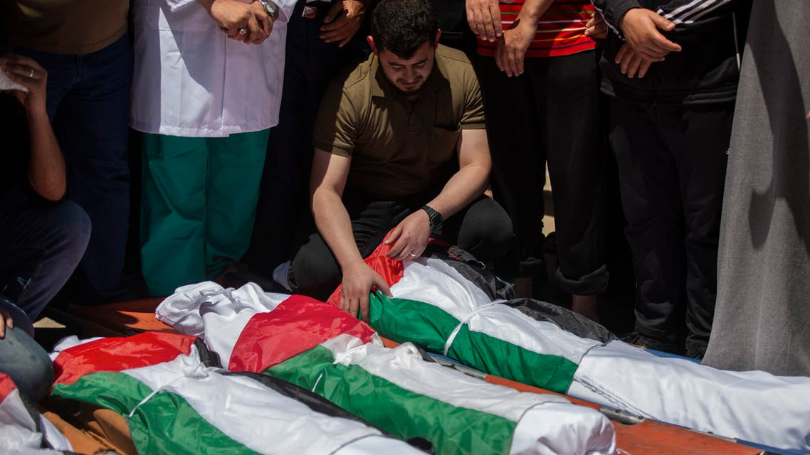 Palestinians attend the funeral of two women and eight children of the Abu Hatab family in Gaza City, who were killed after an Israeli air strike, Saturday, May 15, 2021. (AP)