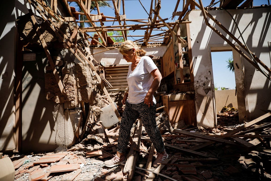 Rachel El-Gazar walks inside her house that was damaged following a rocket fire from Gaza towards Israel in the city of Sderot, southern Israel May 15, 2021. (Reuters)