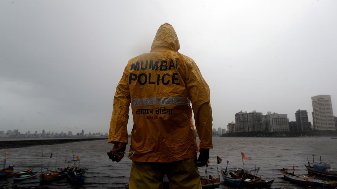 A Mumbai police official stands guard off the coast of the Arabian sea in Mumbai as cyclone Nisarga makes its landfall, on the outskirts of Mumbai, India, June 3, 2020. (File photo: Reuters)