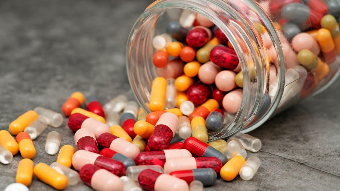 Pills spilling out of a jar. stock photo