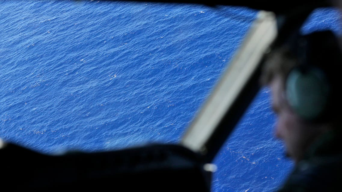 File photo of a New Zealand airforce pilot flying over the southern Indian Ocean, near the coast of Western Australia, Monday, March 31, 2014. (AP)