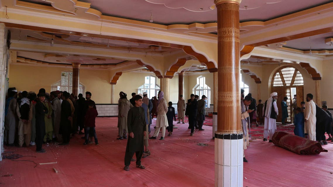 Devotees gather inside a mosque after a bomb blast on the outskirts of Kabul on May 14, 2021, that killed at least 12 people, shattering the relative calm of a holiday ceasefire between the warring Taliban and government forces. (AFP)