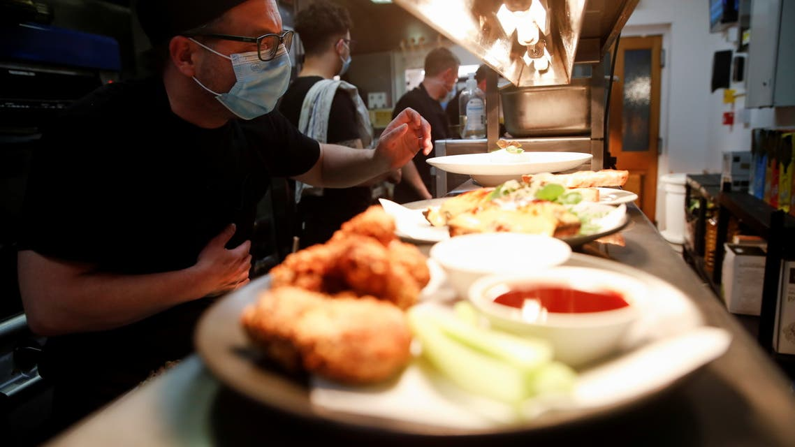 Chefs prepare food before a new menu tasting for staff at Loxleys Restaurant & Wine Bar before reopening on Monday 17th, as coronavirus disease (COVID-19) restrictions continue to ease, in Stratford Upon Avon, Britain, May 14, 2021. (Reuters)