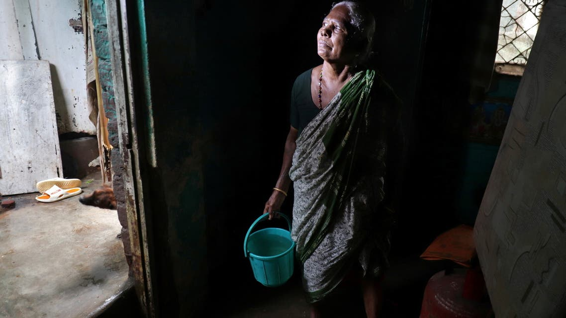 A woman stands as she removes water from her house after Cyclone Nivar's landfall, in Chennai, India, November 26, 2020. (File photo: Reuters)