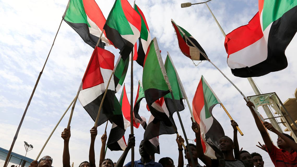 People wave national flags as they demonstrate against the killing of protesting children, who were shot dead when security forces broke up a student protest in Khartoum, Sudan August 1, 2019. (Reuters)