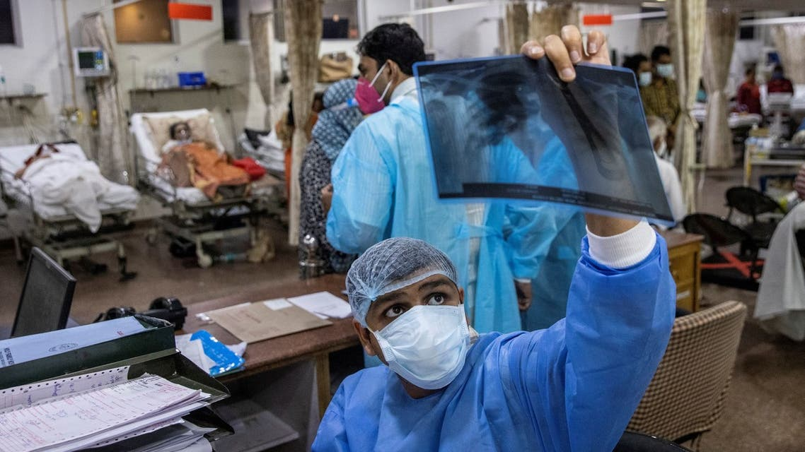 Rohan Aggarwal, 26, a resident doctor treating patients suffering from the coronavirus disease (COVID-19), looks at a patient's x-ray scan during his 27-hour shift at Holy Family Hospital in New Delhi, India, May 1, 2021. If a patient has a fever, and I know he's sick but he's not requiring oxygen, I can't admit him, said Aggarwal. That's the criteria. People are dying on the streets without oxygen. So people who don't require oxygen, even if they are sick, we don't admit them usually, he added. Another choice is I have an old male and I have a young guy. Both are requiring high-flow oxygen; I have only one bed in the ICU. And I can't be emotional at that time, that he is a father to someone. The young have to be saved. REUTERS/Danish Siddiqui SEARCH SIDDIQUI AGGARWAL FOR THIS STORY. SEARCH WIDER IMAGE FOR ALL STORIES